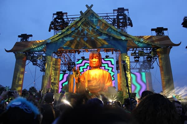 7.5m inflatable buddha at a festival stage