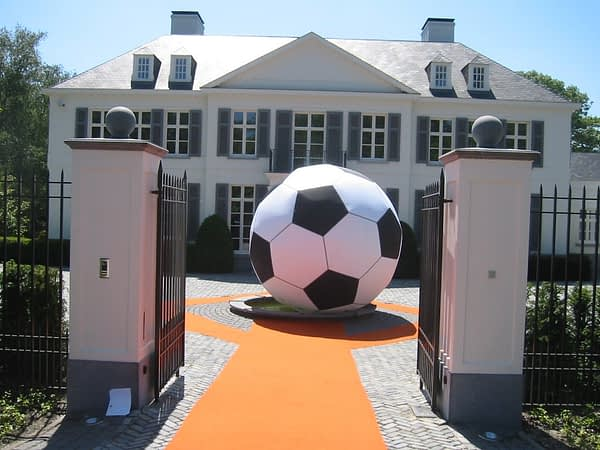 4m inflatable football outside in a courtyard