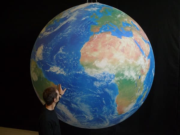 2m printed globe hanging in the studio